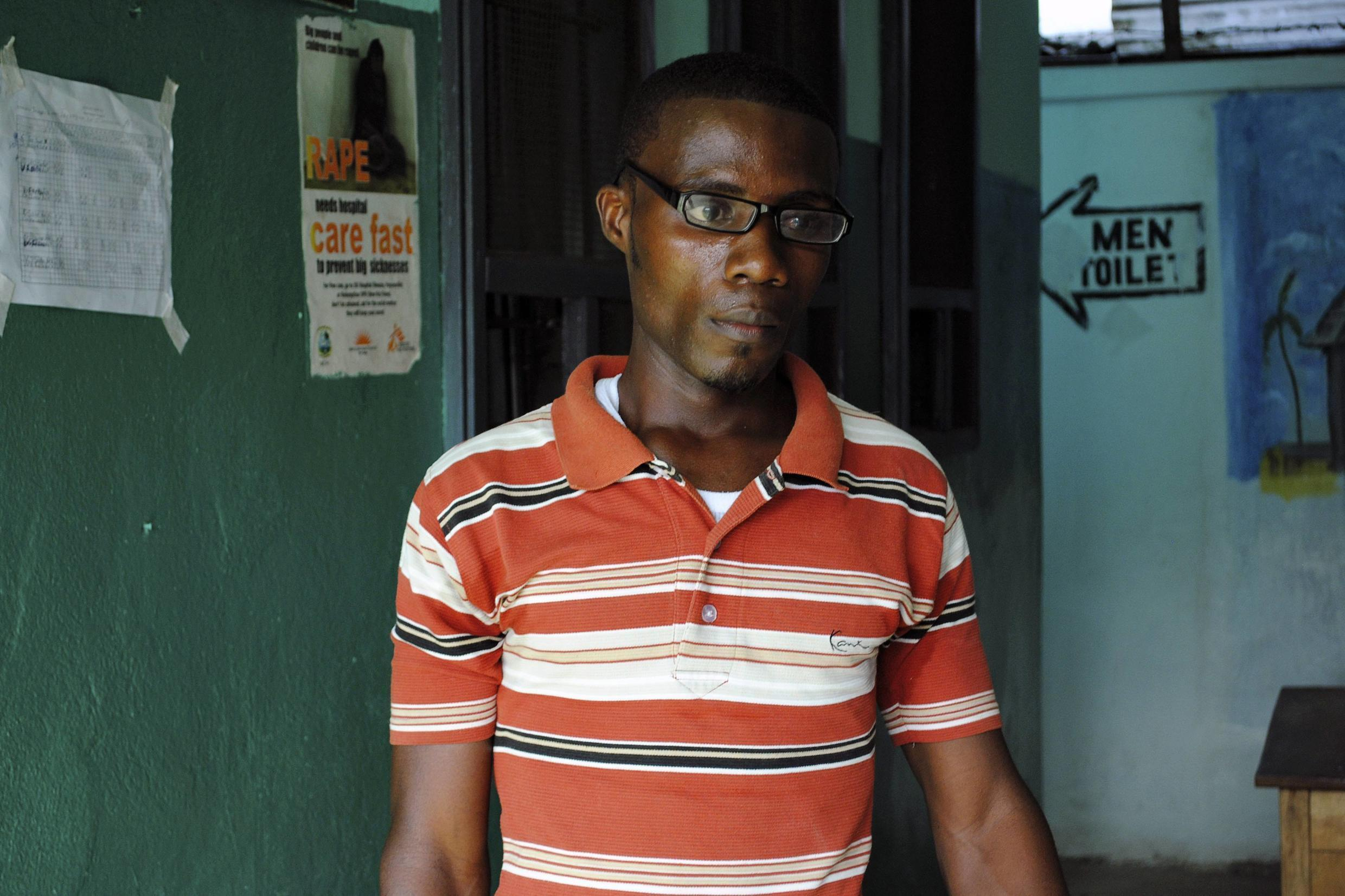 Ebola survivor Romeo Doe poses for a picture at a clinic in Monrovia, 1 February 2015.
