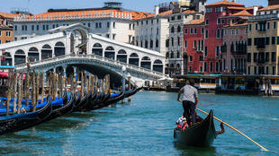 The gondoliers are back in action as tourists flock back to Venice