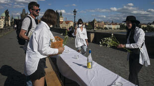 Prague residents celebrated the end of lockdown with a dinner on the city's historic Charles Bridge
