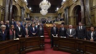 "Catalan president Carles Puigdemont (C) sings the Catalan anthem ""Els Segadors"" at the Catalan parliament on Friday"