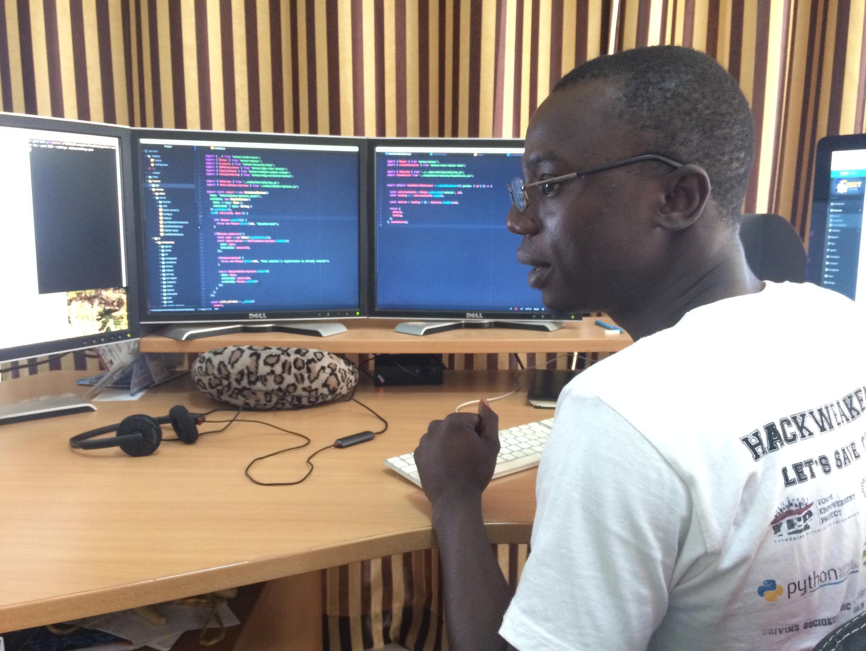 Hassan Jallow reviews code at the Assutech offices in Brufut Gardens.