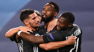 Lyon forward Moussa Dembélé (centre) scored two goals after coming off the substitute's bench in his side's 3-1 victory over Manchester City.