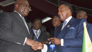 Le président de RDC Félix Tshisekedi (G) et son homologue du Congo-Brazzaville Denis Sassou-Nguesso à l'ouverture du sommet de l'Union africaine, le 7 juillet 2019.