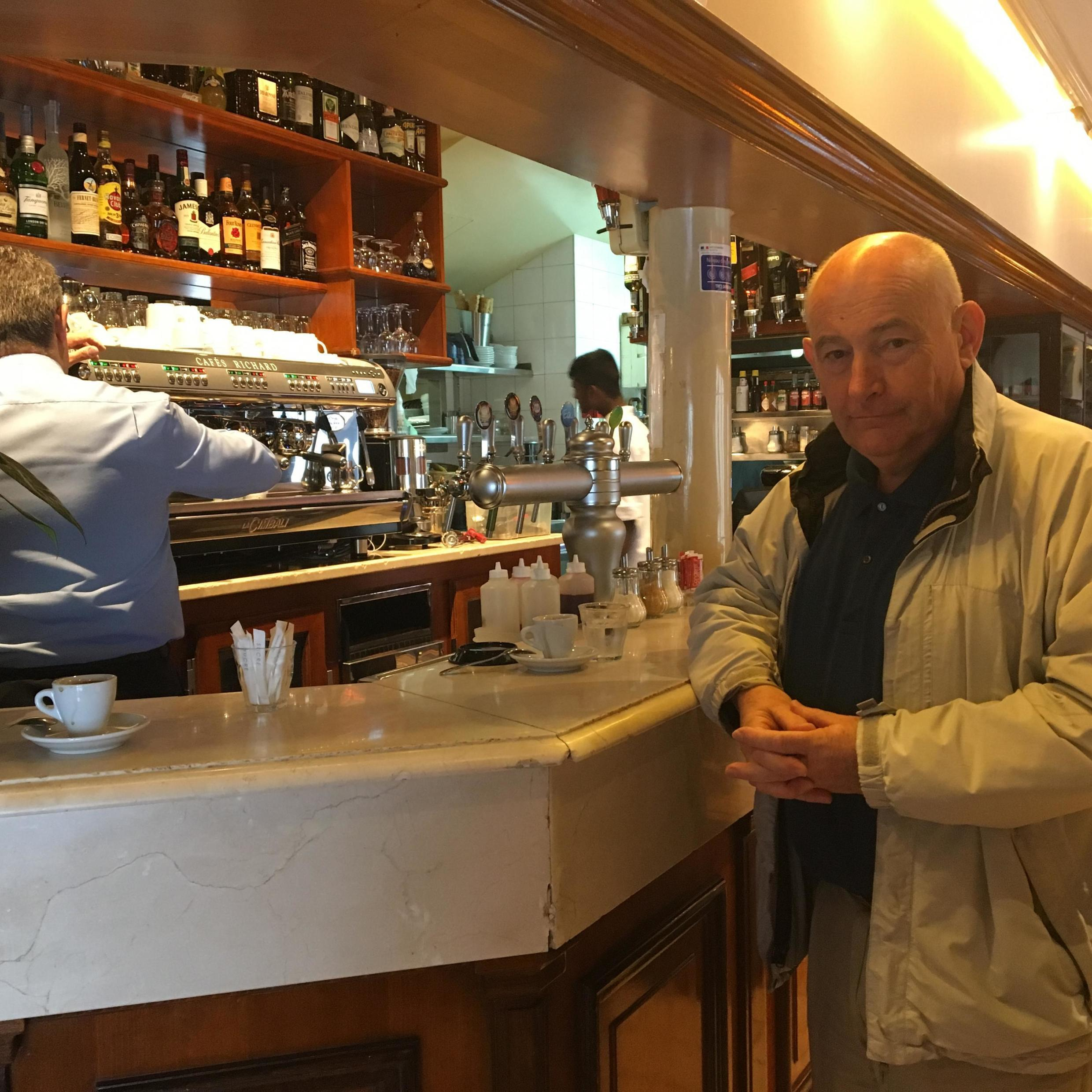 Michel Mathieu, from the Notre Dame shopkeepers association, trying to boost moral in one of the worst-hit cafés