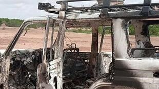 The burnt-out vehicle of eight people, including six French citizens, that was attacked by unidentified gunmen in southwest Niger
