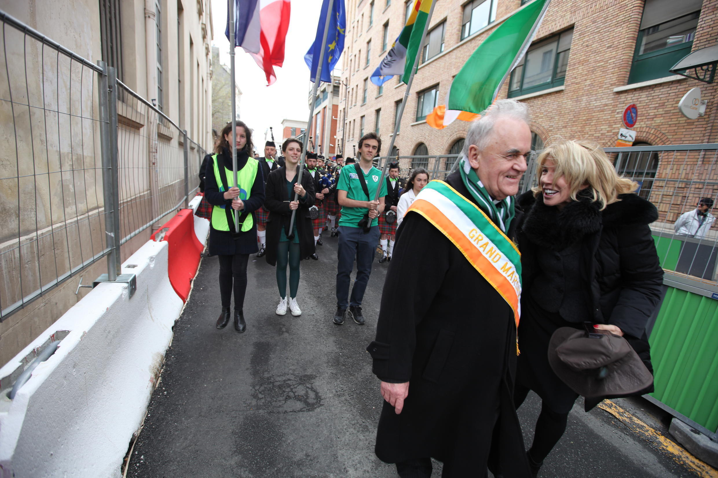 The procession finally begins! The Grand Marshal leads the parade, briefly crossing with Patricia O'Brien, Irish Ambassador to France.