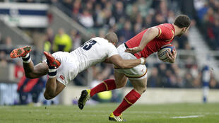 England's Jonathan Joseph tackles Wales' George North in their match at Twickenham on Saturday.