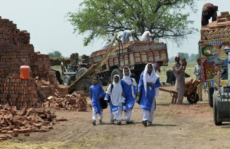 Former Pakistani child labourers leave a school in Lahore, where they benefit from government efforts to pull them out of bonded labour. Campaigners estimate more than two million Pakistanies are trapped in cycles of debt bondage, a form of modern slavery.