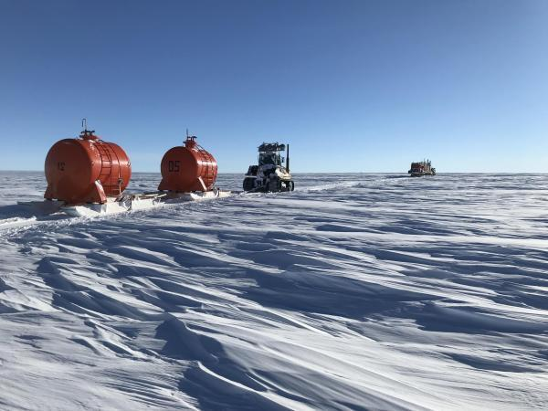 """Caravan moving across a sastrugi field, part of a convoy of some 250 tonnes of research and life support equipment that moved about 10 km/h in Antarctic """"summer"""" temperatures (between -25 and -45 degrees Celsius)."""