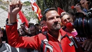 Jerome Kerviel, former trader of French bank Societe Generale, waves to supporters as he arrives on the Italian side of the border with France near the French town of Menton, May 17, 2014.
