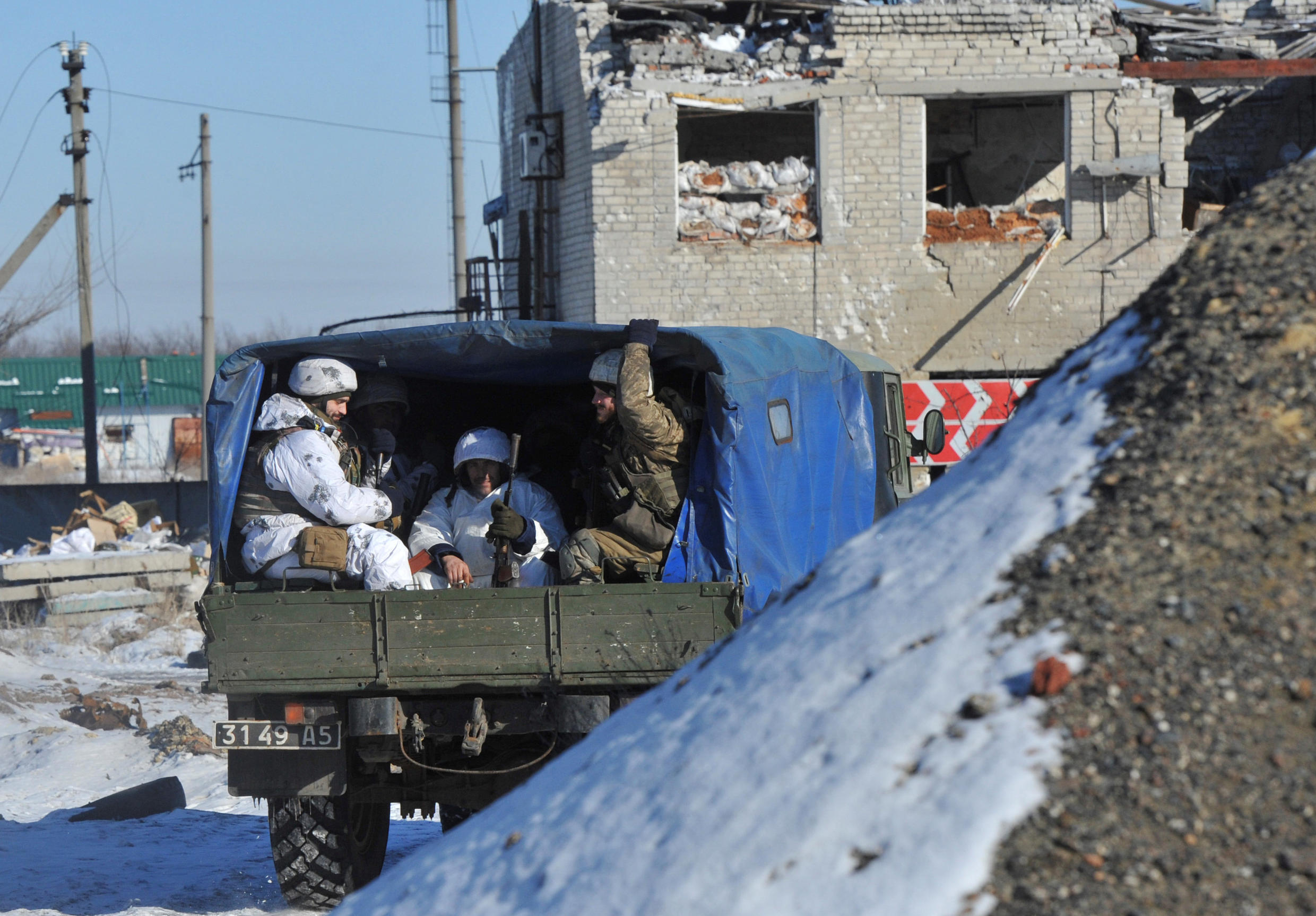 Members of the Ukrainian armed forces drive a military vehicle at their position on the front line near the government-held town of Avdiyivka, 9 February, 2017