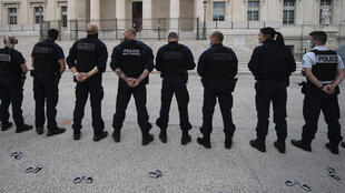 French police officers stand back in front of Marseille's High Court as they threw their handcuffs on the ground during a gathering in Marseille, southern France on June 11, 2020, to protest against measures to counter police violence.
