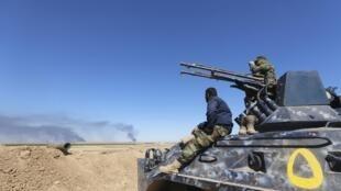 Milices chiites à al-Hadidiya, au sud de Tikrit, le 6 mars 2015.