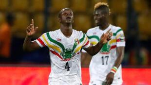 Amadou Haidara (left) scored Mali's winner against Angola.