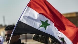 O exército sírio em Tal Tamr, no nordeste da Síria junto à fronteira com a Turquia, no 15 de Outubro de 2019.