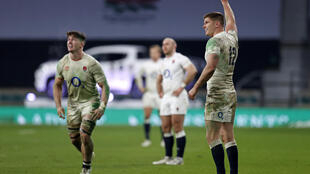 Owen Farrell (R) celebrates his winning sudden death extra-time penalty as England beat France 22-19 in the Autumn Nations Cup final
