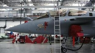 French Rafale jets in hangars.