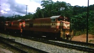 Train carrying iron ore from Tokadeh to the port of Buchanan.