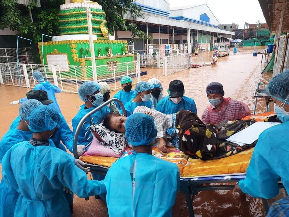 2021-07-27T075347Z_383571109_RC2VSO94HVB7_RTRMADP_3_HEALTH-CORONAVIRUS-MYANMAR-FLOODS