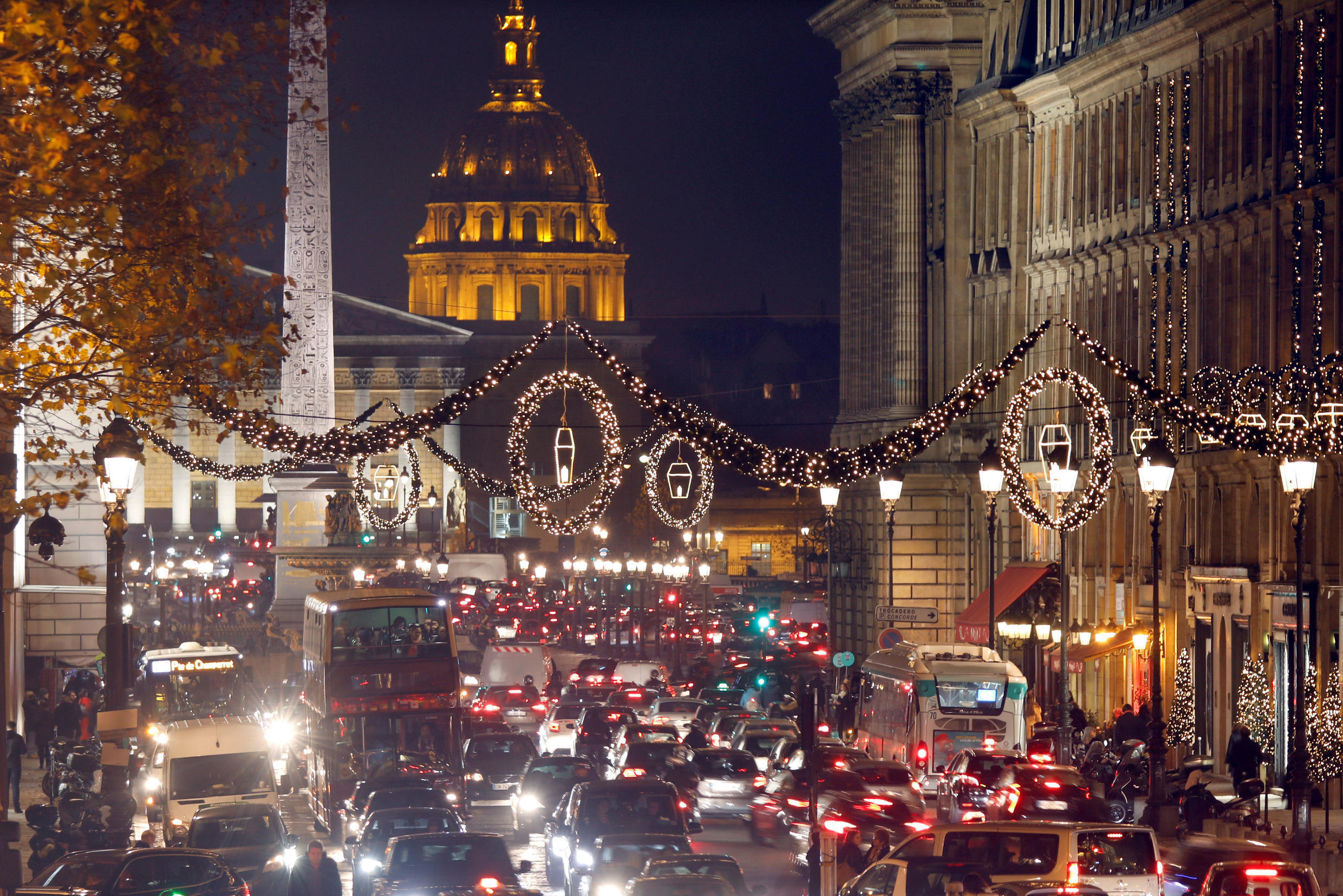 Christmas lights illuminate the rue Royale in front of the Place de la Concorde, the Luxor Obelisk, the National Assembly and the Dome des Invalides as part of illuminations for the Christmas season in Paris, France, December 5, 2017.