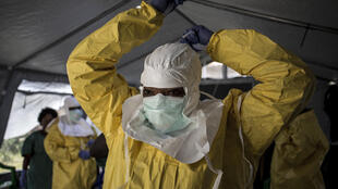 An Ebola worker in DR Congo dons full protective gear against the lethal virus