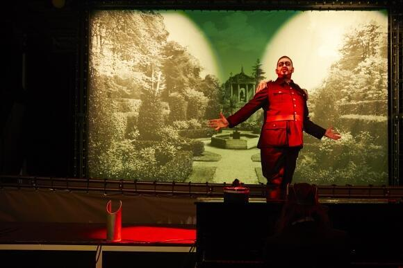 """The war-mongering general is """"the only burst of red in all this green"""" in Olivier Py's 'Love Triumphant'"""