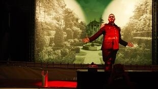 "The war-mongering general is ""the only burst of red in all this green"" in Olivier Py's 'Love Triumphant'"
