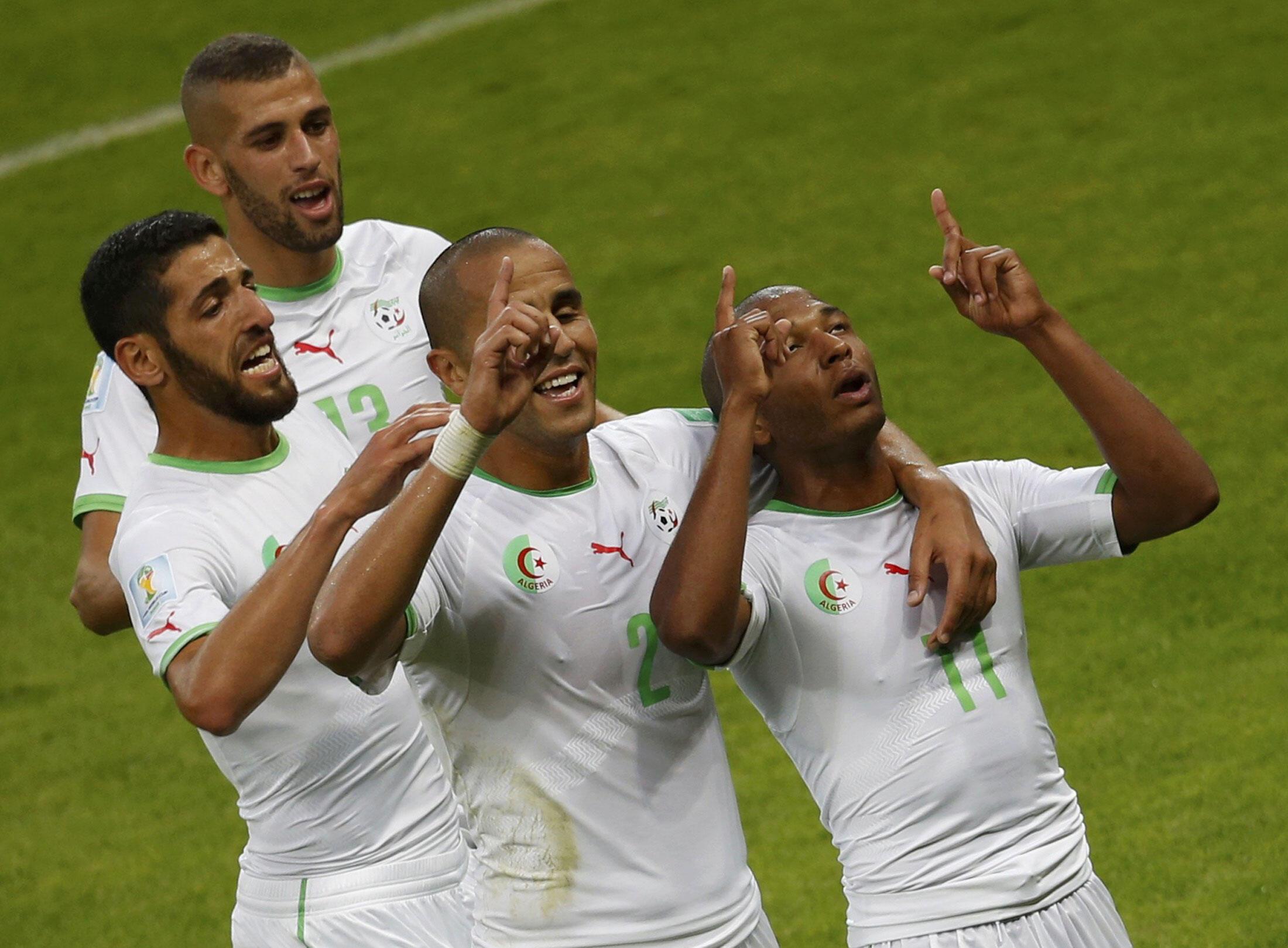 Islam Slimani, Rafik Halliche, Madjid Bougherra et Yacine Brahimi lors du Mondial 2014 au Brésil. .