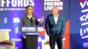 Former Representative Gabby Giffords her husband Mark Kelley speaking at the rally
