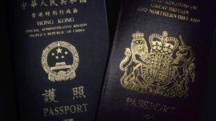 A British National Overseas passports (BNO) and a Hong Kong Special Administrative Region of the People's Republic of China passport are pictured in Hong Kong, Friday, Jan. 29, 2021. China said Friday it will no longer recognize the British National Overseas passport as a valid travel document or form of identification amid a bitter feud with London over a plan to allow millions of Hong Kong residents a route to residency and eventual citizenship.