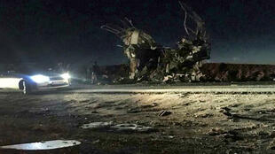 Iran's Fars news agency released a photo showing what it said was the wreckage of the bus