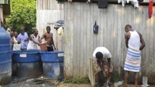 Cerca de 200 haitianos aguardam visto provisório para trabalhar no pais. Eles vivem em condições precárias, e se alimentam de doações. Brasilieia (Acre)