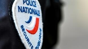 This photo shows the badge of a French police officer in Lille, northern France.