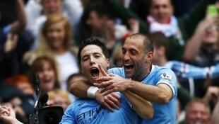 O francês Samir Nasri abriu o placar na vitória deste domingo, que garantiu o título ao Manchester City.