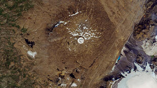 Image satellite diffusée par la Nasa le 1er août 2019 du glacier islandais Okjökul qui a pratiquement disparu, englouti par le réchauffement climatique.