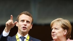 French President Emmanuel Macron with German Chancellor Angela Merkel after being awarded the Charlemagne Prize in Aachen, Germany, last month