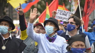 Ecuadoran presidential candidate Yaku Perez (C) waves to supporters during a rally demanding a recount in weekend elections