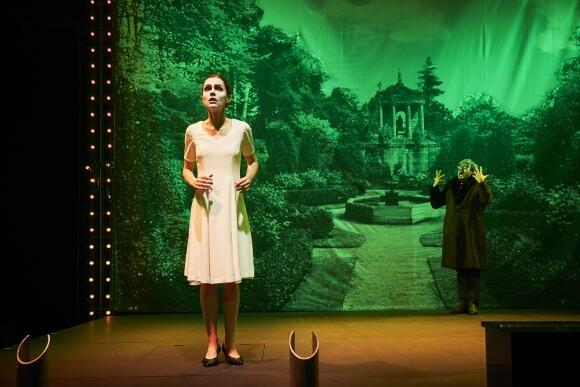 Clémentine Bourgoin as the Princess and Pierre Lebon as the Prince, with Pierre-André Weitz's photo-garden backdrop and theatrical lighting in Love Triumphant, Avignon Festival 2019