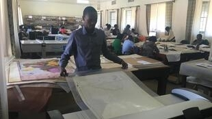 A Ugandan worker registers maps and surveys in the National Land Information System (NLIS) that was rolled out on 20 February 2020