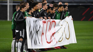 "Protest: German players hold up a banner ""We for 30"""