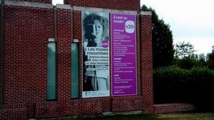 A huge poster outside the entrance to the LaM where an audiovisual exhibition shows French 1970s feminism leapt on video film and joined a worldwide movement, August 2019