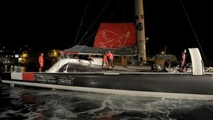 The IDEC SPORT maxi-trimaran, skipped by France's Francis Joyon takes the start of the Jules Verne Trophy, a crewed round the world record attempt in 2016 in Brest, western France.