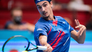 What a shock: Italy's Lorenzo Sonego returns the ball to Novak Djokovic