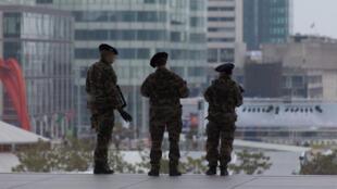 Police patrol La Défense earlier this month