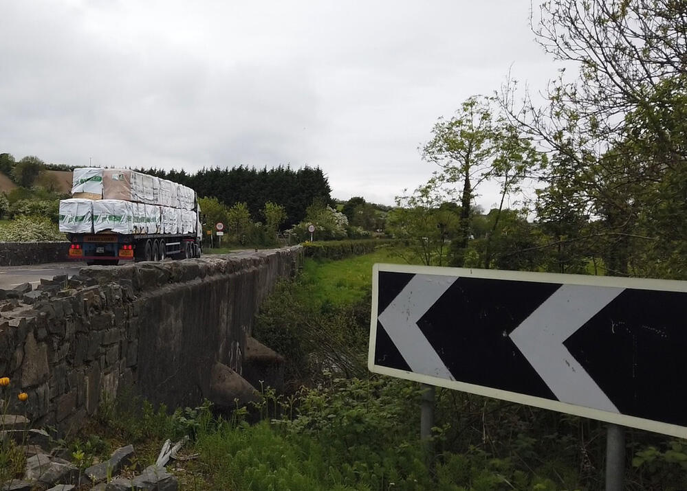 A heavily loaded truck crosses the border between Northern Ireland and the Irish Republic near the town of Cullaville.