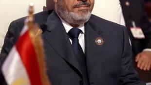 Le président déchu Mohamed Morsi. (Ici au sommet de la Ligue arabe à Doha, le 3 juillet 2013.)