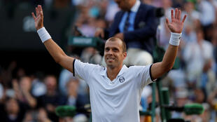 Gilles Muller beat two time champion Rafael Nadal to progress to the last eight at Wimbledon for the first time in his career.