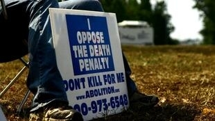 An activist protests the death penalty in front of Greensville prison in September 2010.