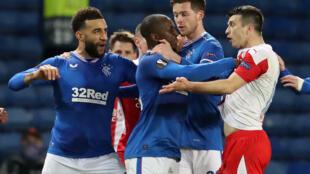 Rangers' Finnish midfielder Glen Kamara, centre, grabbed Slavia Prague Czech defender Ondrej Kudela as the pair clashed in a Europa League tie