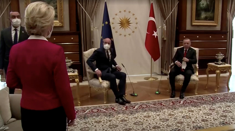 Ursula von der Leyen stands as European Council President Charles Michel and Turkish President Tayyip Erdogan